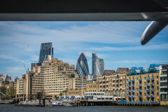 Apartmenst on the bank of river Thames. Residential and commercial buildings as seen from the river Thames, London, UK Royalty Free Stock Photos