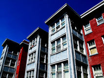 Apartment. Rows of Apartment Buildings with Blue Sky in Background Royalty Free Stock Images