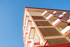 Apartment block architecture with balcony at blue sky Stock Photo