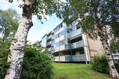 Apartment block building with green lawn and trees Royalty Free Stock Image
