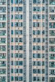 Apartment block in China- Rabbit hutches building. Bright view of a modern apartment block in China - Rabbit hutches building concept Stock Photos