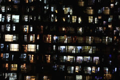 Apartment block at night Stock Photos