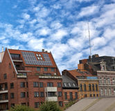 Apartment block with solar panels on the roof. Solar panels on the roof of an apartment  block Royalty Free Stock Photos