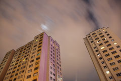 Apartment blocks from below with long exposure at night Stock Photos