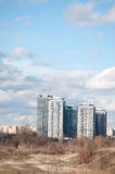 Apartment blocks in the field Stock Image