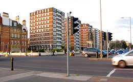 Apartment blocks on Grand Avenue in Hove England. Seventies style apartment blocks on the Grand Avenue and a statue of Queen Victoria facing the Kingsway Road in Stock Photos