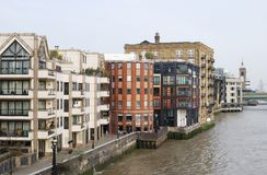 Apartment blocks on River Thames. London. England Stock Photo
