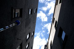 Apartment buidings. A view looking up between two apartment buildings Royalty Free Stock Image