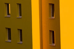 Apartment building. Detail of yellow apartment building Stock Images