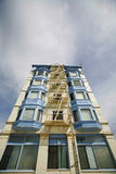 Apartment Building. 6 story blue and white apartment building with fire escape Royalty Free Stock Images