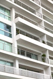 Apartment Building. Detail of a modern multi-storey apartment building with balconies Stock Image
