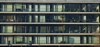 Apartment building. With glass facade and balcony Royalty Free Stock Photography