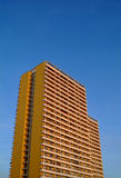 Apartment building. A picture of a new apartment block against clear blue sky in East Berlin, Germany Stock Photo