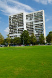 Apartment building. With big lawn and parking Royalty Free Stock Image