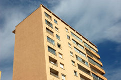 Apartment Building. Against cloudy sky Stock Photography