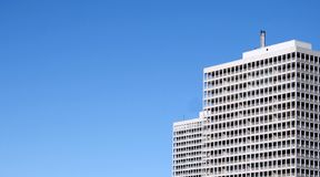 Apartment Building. A white apartment building against a blue sky Stock Photography