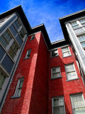Apartment Building. Rows of Apartment Buildings with Blue Sky in Background Royalty Free Stock Image