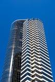 Apartment building against blue sky. Apartment building modern style against clear blue sky Stock Photo