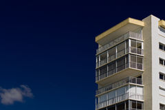 Apartment building against deep blue sky Stock Image