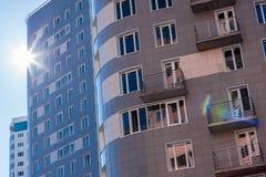 Apartment building against sun Stock Photos