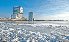 Apartment building along a frozen lake Stock Photo