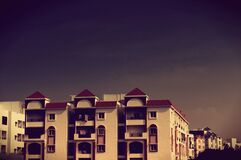 Apartment Building with Balconies at Dusk Stock Photography