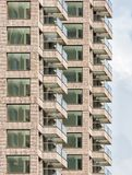 Apartment building with balconies Stock Images
