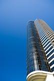 Apartment building blue sky. Apartment building with plenty of copyspace against blue sky Stock Photos