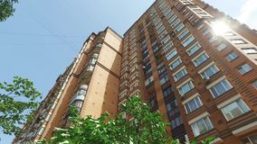 Apartment building brick color in city at summer stock video