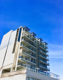 Apartment building. City apartments from below with blue sky in the city Royalty Free Stock Images