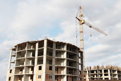 Apartment building at a construction site. Photo of an apartment building at a construction site Royalty Free Stock Images