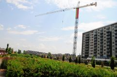 Apartment building & crane, Canada Royalty Free Stock Images