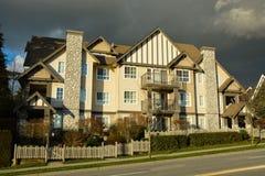 Apartment building on dark sky background. Winter season in Canada Stock Photos