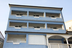 Apartment building exterior. Exterior view of facade of blue apartment building Stock Photos