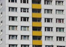 Apartment Building Facade with Yellow Color Balcony Stock Photos