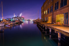 Apartment building and marina at night on the waterfront in Fell Royalty Free Stock Image