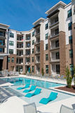 Apartment building. Modern apartment complex courtyard with swimming pool Stock Photo