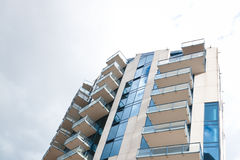 Apartment Building. A modern apartment building with large balconies Royalty Free Stock Images
