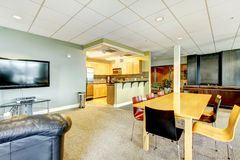 Apartment building modern living room with kitchen general area. Royalty Free Stock Photos