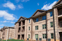 Apartment building. New apartment complex buildings on bright day Royalty Free Stock Images