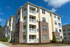 Apartment building. New apartment complex buildings on bright day Royalty Free Stock Image