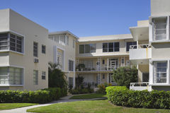 Apartment building with palm trees Royalty Free Stock Image