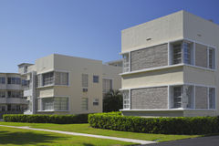 Apartment building with palm trees Stock Photo
