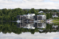 Apartment building reflecting on a lake Stock Images