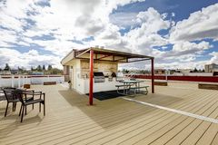 Apartment building roof top grill. Apartment building roof top deck with grill and sitting area Stock Images