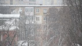 Apartment building in snowfall stock video footage