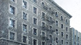 Apartment Building In Snowfall. Typical apartment building with snow falling stock video footage
