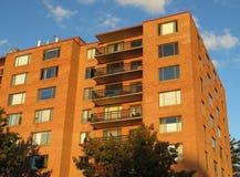Apartment Building at Sunset Stock Photos