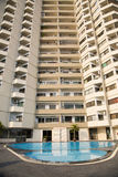 Apartment building. An apartment building with a swimming pool downstairs Stock Image