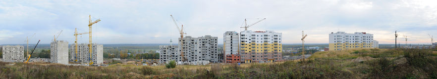 Apartment building under construction. Panoramic view of the apartment building under construction in autumn Stock Photography